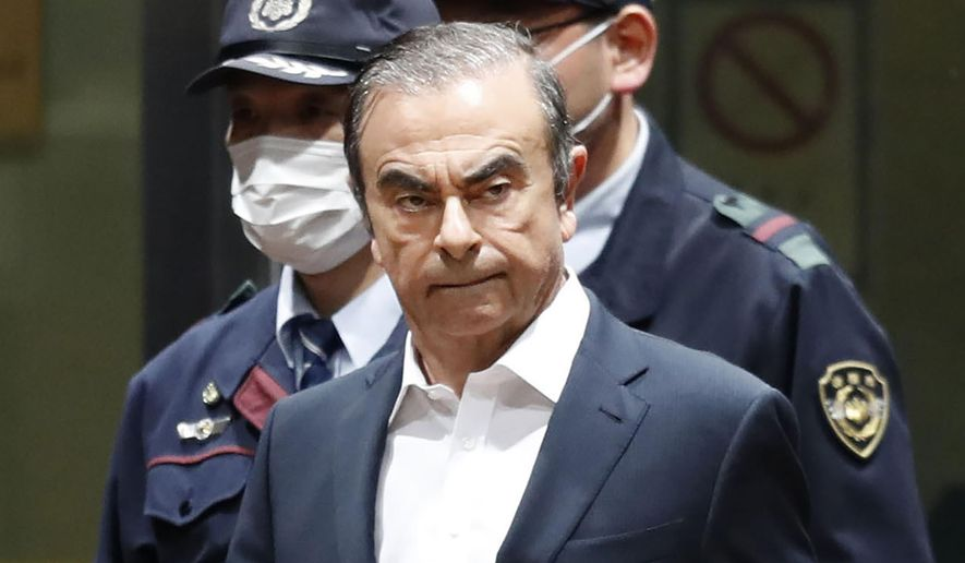 FILE - In this April 25, 2019, file photo, former Nissan Chairman Carlos Ghosn leaves Tokyo Detention Center in Tokyo. Ghosn plans a news conference later Friday, June 28, that would be his first since he was arrested in November on financial misconduct allegations.(Kyodo News via AP, File)