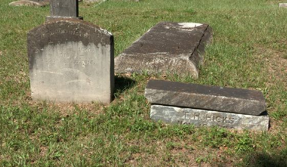 This undated photo shows the grave of Caroline Hicks, at left, one of seven moved from the now-forgotten Zion Cemetery to Memorial Park, another African-American cemetery in Tampa, Fla. (James Borchuck/Tampa Bay Times via AP)