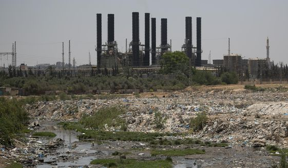 A general view of the Gaza's electrical Gaza's only electrical plant that generates electricity in the central Gaza Strip, Thursday, June 27, 2019. Israel made decision to stop the entry of fuel into the Strip after multiple flaming balloons landed in its territory. (AP Photo/Hatem Moussa)