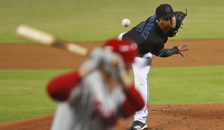 Miami Marlins' Elieser Hernandez, top, pitches to Philadelphia Phillies' Rhys Hoskins during the first inning of a baseball game, Friday, June 28, 2019, in Miami. (AP Photo/Wilfredo Lee)
