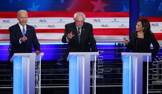 Democratic presidential candidate, former vice president Joe Biden, left, Sen. Bernie Sanders, I-Vt., and Sen. Kamala Harris, D-Calif., speak simultaneously during the Democratic primary debate at the Adrienne Arsht Center for the Performing Arts, Thursday, June 27, 2019, in Miami. (AP Photo/Wilfredo Lee)