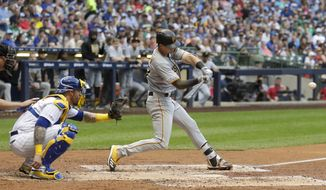 Pittsburgh Pirates' Kevin Newman hits a home run during the third inning of a baseball game against the Milwaukee Brewers Friday, June 28, 2019, in Milwaukee. (AP Photo/Morry Gash)
