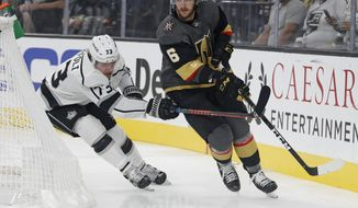 FILE - In this Sept. 28, 2018, file photo, Vegas Golden Knights defenseman Colin Miller (6) skates around Los Angeles Kings right wing Tyler Toffoli during the first period of a preseason NHL hockey game in Las Vegas. A person with direct knowledge of the move tells The Associated Press that the Buffalo Sabres have acquired Miller from the Golden Knights for a pair of draft picks. The Golden Knights acquired a second-round pick in the 2021 draft and a 2022 fifth-round selection. The person spoke Friday, June 28, on the condition of anonymity because the trade had not yet been announced. (AP Photo/John Locher, File)