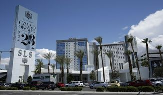 FILE - In this Aug. 20, 2014 photo, cars drive past the SLS Las Vegas in Las Vegas. The SLS hotel on the Las Vegas Strip is going back to the Sahara name. The iconic hotel that dates to 1952 and over the years hosted the Rat Pack, the Jerry Lewis Telethon and the Beatles came full circle with a Thursday, June 27, 2019 announcement by new owner Alex Meruelo. (AP Photo/John Locher, file)