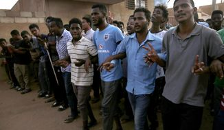 Sudanese protesters shout slogans, as they march during a protest against the military council, in Khartoum, Sudan, Thursday, June 27, 2019. The U.S. envoy to Sudan has expressed America's support for the Sudanese protest movement and has called for a civilian-led government amid stalled negotiations between the pro-democracy leaders and the ruling military.(AP Photo/Hussein Malla)
