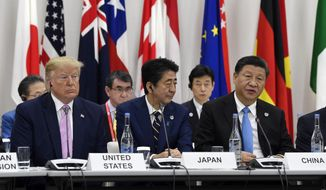 Chinese President Xi Jinping, right, speaks at the G-20 summit event on the Digital Economy in Osaka, Japan, Friday, June 28, 2019. President Donald Trump, left, and Japanese Prime Minister Shinzo Abe, center, listen. (AP Photo/Susan Walsh)