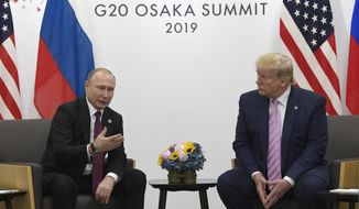 President Donald Trump, right, meets with Russian President Vladimir Putin during a bilateral meeting on the sidelines of the G-20 summit in Osaka, Japan, Friday, June 28, 2019. (AP Photo/Susan Walsh)