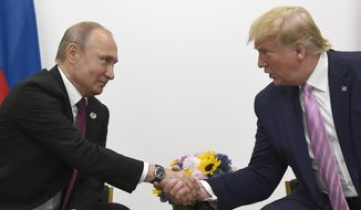 President Donald Trump, right, shakes hands with Russian President Vladimir Putin  during a bilateral meeting on the sidelines of the G-20 summit in Osaka, Japan, Friday, June 28, 2019. (AP Photo/Susan Walsh) **FILE**