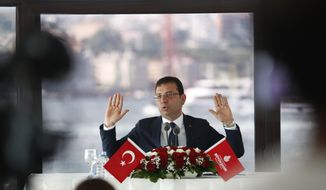 Ekrem Imamoglu, the new Mayor of Istanbul from Turkey's main opposition opposition Republican People's Party (CHP) talks to members of foreign media a day after he took over office, in Istanbul, Friday, June 28, 2019. Imamoglu said Friday he was prepared against any attempts by the government to restrict his powers while emphasizing his willingness to work with Turkish President Recep Tayyip Erdogan.(AP Photo/Lefteris Pitarakis)