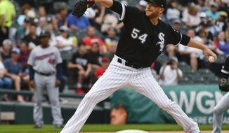 Chicago White Sox starting pitcher Ross Detwiler delivers during the first inning of the team's baseball game against the Minnesota Twins on Friday, June 28, 2019, in Chicago. (AP Photo/Matt Marton)