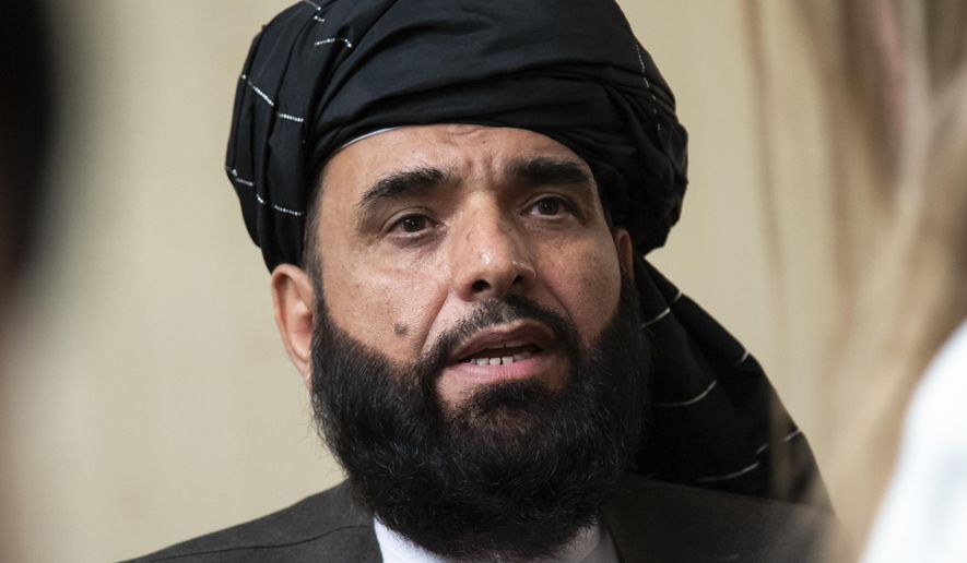 In this May 28, 2019, file photo, Suhail Shaheen, spokesman for the Taliban's political office in Doha, speaks to the media in Moscow, Russia. Shaheen told The Associated Press that the Taliban's negotiating team was set to open talks with U.S. peace envoy Zalmay Khalilzad. He has been in the region for several weeks meeting a legion of regional and Afghan officials, including Afghan President Ashraf Ghani. (AP Photo/Alexander Zemlianichenko, File)