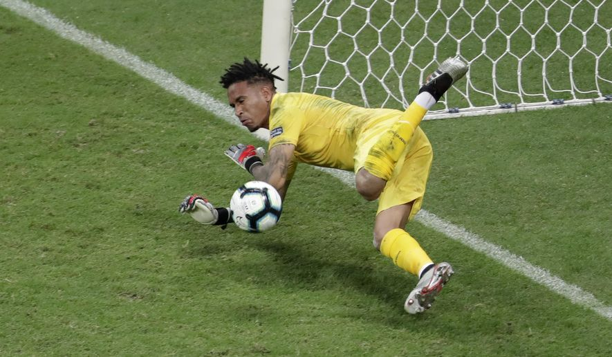Peru's goalkeeper Pedro Gallese stops a penalty shot during a Copa America quarterfinal soccer match against Uruguay at the Arena Fonte Nova in Salvador, Brazil, Saturday, June 29, 2019. (AP Photo/Eraldo Peres)