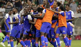 Haiti celebrates a 3-2 win over Canada in a CONCACAF Gold Cup soccer quarterfinal Saturday, June 29, 2019, in Houston. (AP Photo/Michael Wyke)