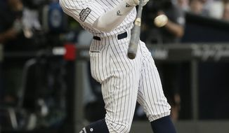 New York Yankees' Aaron Judge hits a two-run home run against the Boston Red Sox during the fourth inning of a baseball game, Saturday, June 29, 2019, in London. Major League Baseball made its European debut game today at London Stadium. (AP Photo/Tim Ireland)