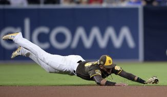 San Diego Padres shortstop Fernando Tatis Jr. dives for a ground ball single hit by St. Louis Cardinals' Michael Wacha during the fourth inning of a baseball game Friday, June 28, 2019, in San Diego. (AP Photo/Orlando Ramirez)