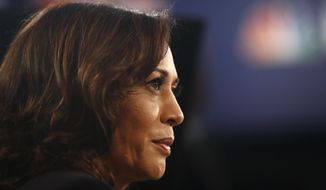 Democratic presidential candidate Sen. Kamala Harris, D-Calif., listens to questions in the spin room after the Democratic primary debate hosted by NBC News at the Adrienne Arsht Center for the Performing Art, Thursday, June 27, 2019, in Miami. (AP Photo/Brynn Anderson)