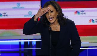 In this June 27, 2019, photo, Democratic presidential candidate Sen. Kamala Harris, D-Calif., gestures during the Democratic primary debate hosted by NBC News at the Adrienne Arsht Center for the Performing Arts in Miami. (AP Photo/Wilfredo Lee)