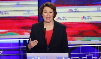 In this June 26, 2019, photo, Democratic presidential candidate Sen. Amy Klobuchar, D-Minn., gestures, during a Democratic primary debate hosted by NBC News at the Adrienne Arsht Center for the Performing Arts in Miami. It's been tough to run for the Democratic presidential nomination as a moderate if your name isn't Joe Biden. But some candidates hope that's changing. (AP Photo/Wilfredo Lee)