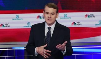 In this June 27, 2019, photo, Democratic presidential candidate Colorado Sen. Michael Bennet speaks during the Democratic primary debate hosted by NBC News at the Adrienne Arsht Center for the Performing Arts, in Miami. (AP Photo/Wilfredo Lee)