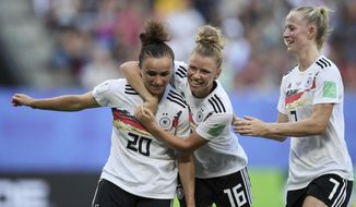Germany's Lina Magull, left, celebrates with teammates Linda Dallmann, middle, and Lea Schueller after scoring her side's first goal during the of the Women's World Cup quarterfinal soccer match between Germany and Sweden at Roazhon Park in Rennes, France, Saturday, June 29, 2019. (AP Photo/David Vincent)