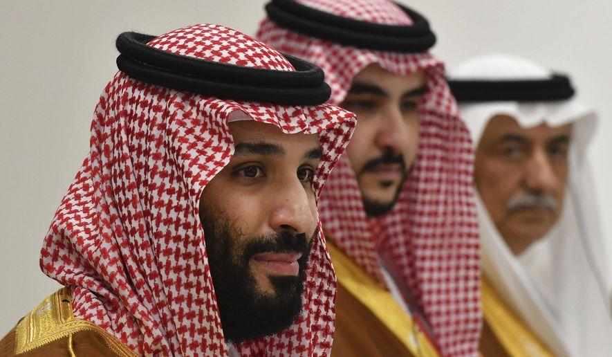 Saudi Arabia's Crown Prince Mohammed bin Salman, left, holds a bilateral meeting with Russia's President Vladimir Putin on the sidelines of the G-20 Summit in Osaka, western Japan Saturday, June 29, 2019. (Yuri Kadobnov/Pool Photo via AP)
