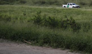 A U.S. Border Patrol car drives along the Rio Grande in Brownsville, Texas, as seen from Matamoros, Tamaulipas state, Mexico, Thursday, June 27, 2019. Hundreds of migrants from Central America, South America, the Caribbean and Africa have been waiting for their number to be called at the bridge in downtown Matamoros, to have the opportunity to request asylum in the U.S. (AP Photo/Rebecca Blackwell)