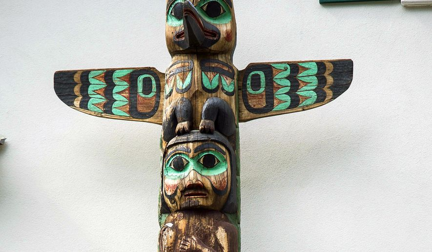 """This June 14, 2019, photo shows the top of the totem at the Governor's House in Juneau, Alaska, an example of totems carved by people employed by the Civilian Conservation Corps. Rural Tennessee has electricity for the same reason Southeast Alaska has totem parks - the New Deal. In order to help the nation recover from the Great Depression, President Franklin D. Roosevelt created a number of federal agencies to put people to work. From 1938-1942 more than 200 Tlingit and Haida men carved totem poles and cleared land for the CCC in an effort to create """"totem parks"""" the federal government hoped would draw travelers to Alaska. (Michael Penn/Juneau Empire via AP)"""