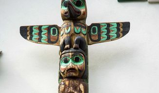 "This June 14, 2019, photo shows the top of the totem at the Governor's House in Juneau, Alaska, an example of totems carved by people employed by the Civilian Conservation Corps. Rural Tennessee has electricity for the same reason Southeast Alaska has totem parks - the New Deal. In order to help the nation recover from the Great Depression, President Franklin D. Roosevelt created a number of federal agencies to put people to work. From 1938-1942 more than 200 Tlingit and Haida men carved totem poles and cleared land for the CCC in an effort to create ""totem parks"" the federal government hoped would draw travelers to Alaska. (Michael Penn/Juneau Empire via AP)"