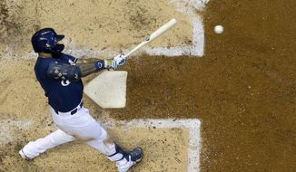 Milwaukee Brewers' Eric Thames hits a home run during the fourth inning of a baseball game against the Pittsburgh Pirates Saturday, June 29, 2019, in Milwaukee. (AP Photo/Morry Gash)