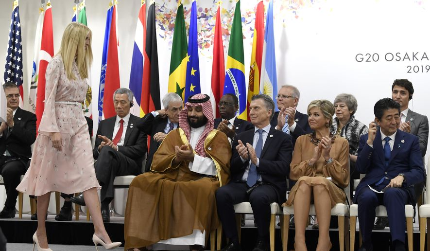 Ivanka Trump, standing, walks back to her seat following her remarks at the G-20 summit event on women's empowerment in Osaka, Japan, Saturday, June 29, 2019. Trump walks past, starting front row right, Japanese Prime Minister Shinzo Abe, Queen Maxima of the Netherlands, Argentine President Mauricio Macri, and Saudi Prince Mohammed bin Salman. (AP Photo/Susan Walsh)