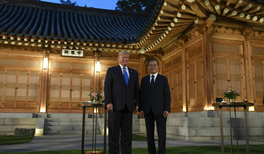 U.S. President Donald Trump, left, and South Korean President Moon Jae-in, right, pose for a photo during a visit to the tea house on the grounds of the Blue House in Seoul, South Korea, Saturday, June 29, 2019. Trump is making a quick trip to Seoul after attending the G-20 summit in Osaka, Japan. (AP Photo/Susan Walsh)