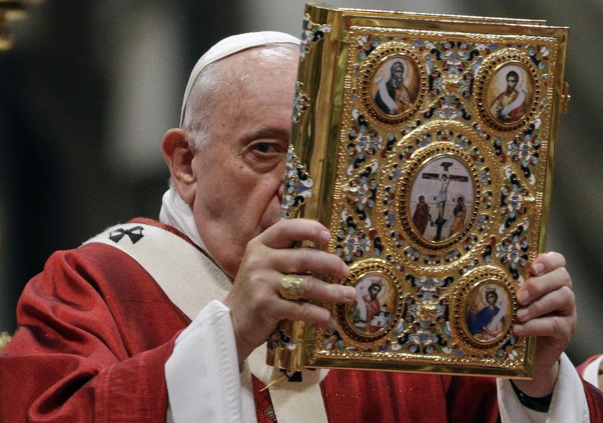 Pope Francis celebrates a Mass where he bestowed the Pallium, a woolen shawl symbolizing their bond to the pope, to new Metropolitan Archbishops, in St. Peter's Basilica at the Vatican, Saturday, June 29, 2019. (AP Photo/Gregorio Borgia)