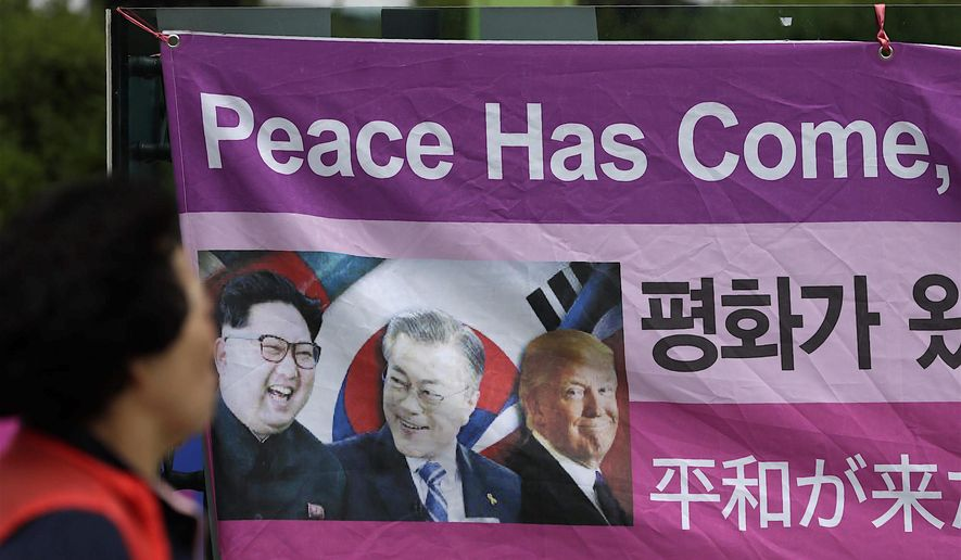A public banner in Seoul spells out local sentiment. One expert now suggests President Trump be nominated for the Nobel Prize. (Associated Press)