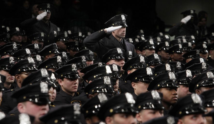 New York Police Department recruits salute as a medley of armed forces anthems is played during graduation ceremonies in New York's Madison Square Garden, Thursday, Dec. 22, 2011. Mayor Michael Bloomberg and Police Commissioner Raymond Kelly presided over the graduation ceremony Thursday for 1,519 new police officers. The graduates have completed more than six months of training at New York City's Police Academy. (AP Photo/Richard Drew)