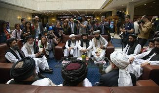 "FILE - In this file photo taken on Tuesday, May 28, 2019, Mullah Abdul Ghani Baradar, the Taliban group's top political leader, left, Sher Mohammad Abbas Stanikzai, the Taliban's chief negotiator, second left, and other members of the Taliban delegation speak to reporters prior to their talks in Moscow, Russia. The seventh and latest round of peace talks between the U.S. and Taliban is ""critical,"" said Taliban spokesman Suhail Shaheen on Sunday June 30, 2019, the second day of talks with Washington's peace envoy Zalmay Khalilzad in the Mideastern state of Qatar, where the militant group maintains a political office. (AP Photo/Alexander Zemlianichenko, File)"