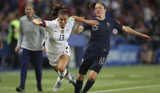 United States' Alex Morgan, left, competes for the ball against France's Elise Bussaglia during the Women's World Cup quarterfinal soccer match between France and the United States at the Parc des Princes, in Paris, Friday, June 28, 2019. (AP Photo/Francisco Seco) **FILE**