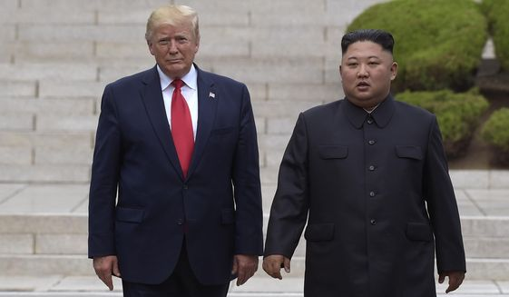 President Donald Trump, left, meets with North Korean leader Kim Jong Un at the North Korean side of the border at the village of Panmunjom in Demilitarized Zone, Sunday, June 30, 2019. (AP Photo/Susan Walsh)
