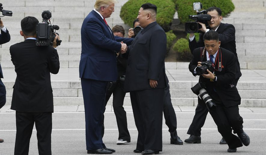President Donald Trump walks to the North Korean side of the border with North Korean leader Kim Jong Un at the border village of Panmunjom in the Demilitarized Zone, South Korea, Sunday, June 30, 2019. (AP Photo/Susan Walsh)