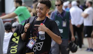 Britain's Paul Jubb smiles as he arrives for a training session ahead of the Wimbledon Tennis Championships in London, Sunday, June 30, 2019. (AP Photo/Ben Curtis)