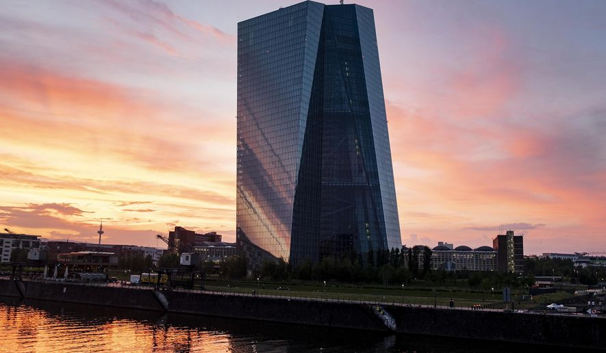 FILE - In this file photo dated Saturday June 22, 2019, The European Central Bank during sunset in Frankfurt, Germany.  The European Central Bank and US Federal Reserve are signalling that more stimulus could be on the way which has sent stocks higher, but an international forum for central bankers is warning Sunday June 30, 2019, that the global economic recovery will need further support to get past its current shaky stretch. (AP Photo/Michael Probst, FILE)