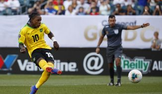 Jamaica's Darren Mattocks makes a goal on a penalty kick during the second half of a CONCACAF Gold Cup soccer match against Panama, Sunday, June 30, 2019, in Philadelphia. (AP Photo/Matt Slocum)