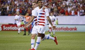 United States' Weston Mckennie, right, celebrates with Tyler Boyd after Mcnennie's goal during the first half of a CONCACAF Gold Cup soccer match against Curacao, Sunday, June 30, 2019, in Philadelphia. (AP Photo/Matt Slocum)