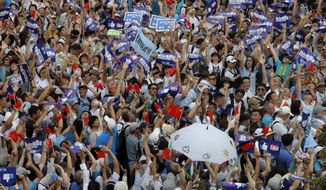 "Pro-China's supporters hold Chinese flags and placards read ""We support police"" during a rally outside Legislative Council Complex in Hong Kong, Sunday, June 30, 2019. Supporters rallied in support of the police at Tamar Park (AP Photo/Kin Cheung)"
