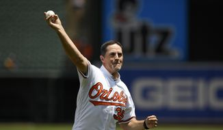 Former Baltimore Orioles pitcher Mike Mussina throws out the ceremonial first pitch before a baseball game between the Baltimore Orioles and the Cleveland Indians, Sunday, June 30, 2019, in Baltimore. (AP Photo/Nick Wass) **FILE**