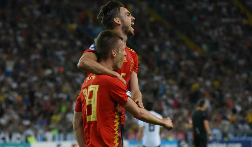 Spain's Dani Olmo jubilates after scoring the goal (2-0) with teammate Fabian Ruiz Pena during the Uefa European Under-21 Championship 2019 - Finals between Spain and Germany in Udine, Italy, Sunday, June 30, 2019. (Gabriele Menis/ANSA via AP)