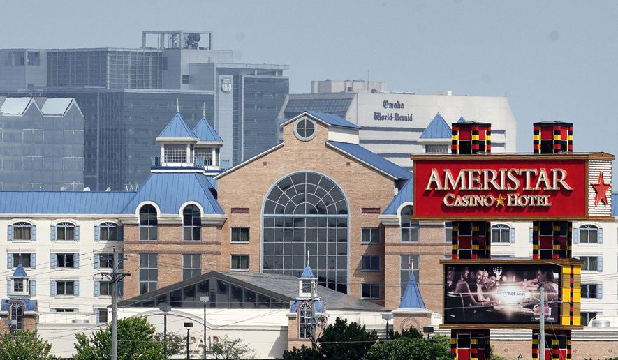 In this June 28, 2019 photo, the Ameristar Casino in Council Bluffs, Iowa, is seen across the river from downtown Omaha, Neb., rear, where casino gambling is prohibited. Nebraska voters may decide next year whether to legalize casino gambling in a ballot measure. (AP Photo/Nati Harnik)