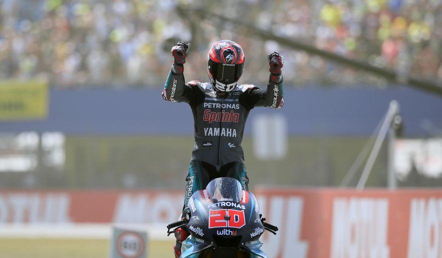 France's rider Fabio Quartararo of the Petronas Yamaha SRT celebrates after finishing third at the MotoGP race during the Dutch Grand Prix in Assen, northern Netherlands, Sunday, June 30, 2019. (AP Photo/Peter Dejong)