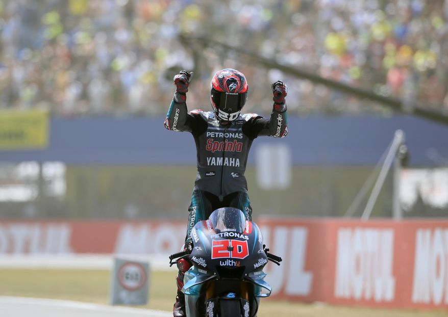 France's rider Fabio Quartararo of the Petronas Yamaha SRT celebrates after finishing third at the MotoGP race during the Dutch Grand Prix in Assen, northern Netherlands, Sunday, June 30, 2019. (AP Photo/Peter Dejong)