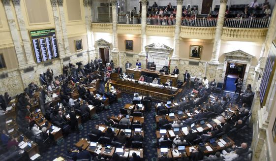 This Monday April 8, 2019 file photo shows State delegates work in the Maryland House of Delegates chamber in Annapolis, Md. on the final day of the state's 2019 legislative session.  (AP Photo/Steve Ruark) **FILE**