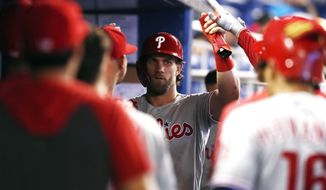 Philadelphia Phillies' Bryce Harper celebrates after scoring during the sixth inning of a baseball game against the Miami Marlins, Sunday, June 30, 2019, in Miami. (AP Photo/Brynn Anderson)